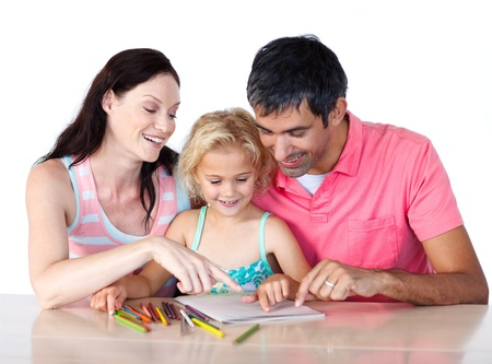 Parents helping their daughter doing homework photo