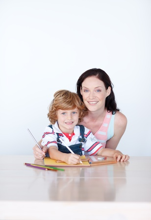 Mother and son drawing with copyspace photo
