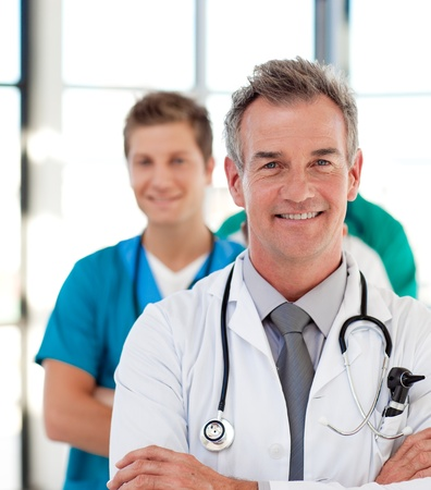 woman doctor: Portrait of a mature doctor leading his team