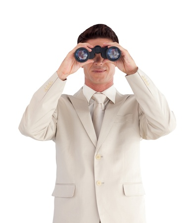 Confident businessman with binoculars photo