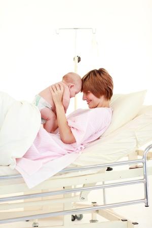 Mother embracing her newborn baby Stock Photo - 10246025