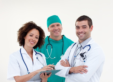 Team of doctors looking at the camera photo