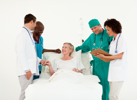 recovering: Team of doctor examining a patient