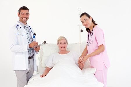 Team of doctor examining a patient Stock Photo - 10249420