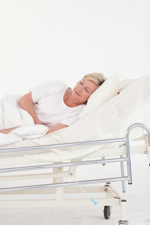 parkinsons: Relaxed senior woman lying on a bed