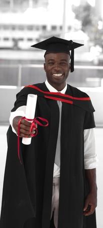 Man smilling at graduation photo