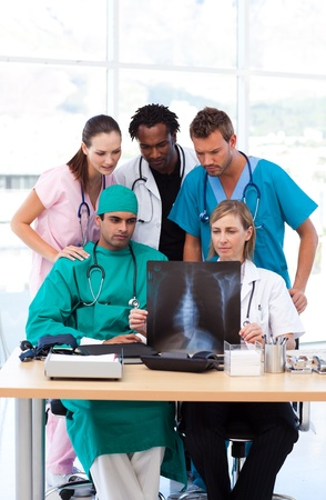 Group of doctors examining an X-ray Stock Photo - 10248478