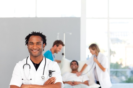 assistants: African doctor with his colleagues in the background with copy-space