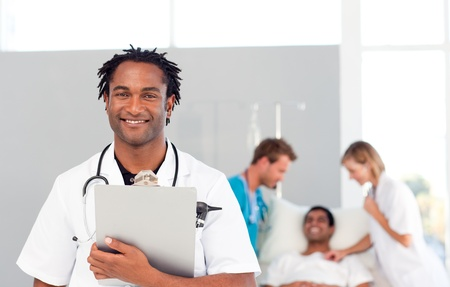 African doctor with a patient in the background photo