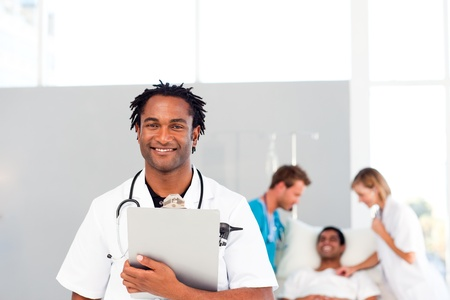 medical attendance: Group of doctors attending to a patient Stock Photo