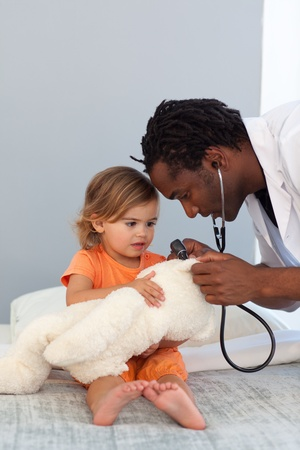 Pediatrician talking to a little girl  photo