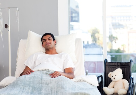 hospital room: Hispanic patient resting in bed
