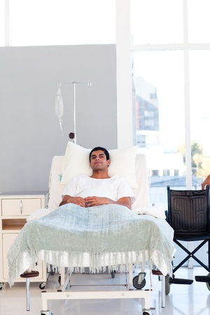recovering: Young patient recovering in bed with copyspace