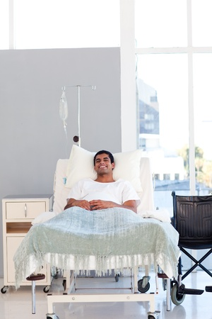 Young patient recovering in bed with copyspace photo
