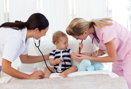 Baby playing with stethoscopes photo