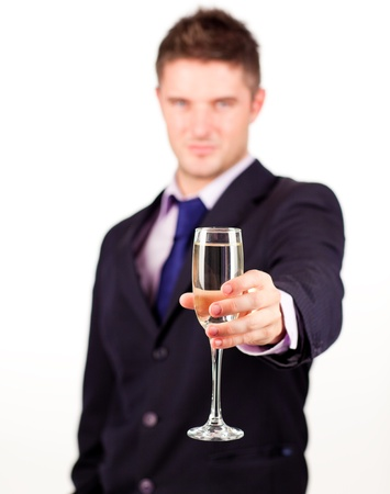 Businessman holding a champagne glass Stock Photo - 10249308