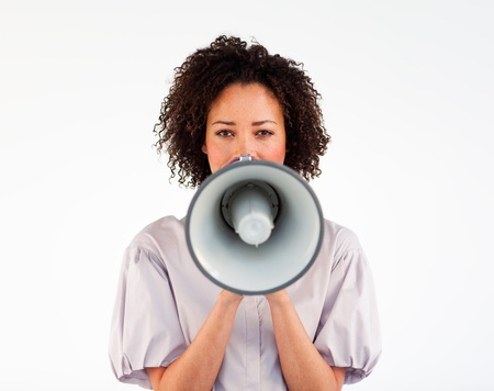 proclaim: Businesswoman speaking through a megaphone in front of the camera