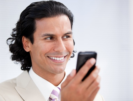 Happy businessman using a mobile phone photo