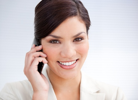 Confident businesswoman talking on phone photo