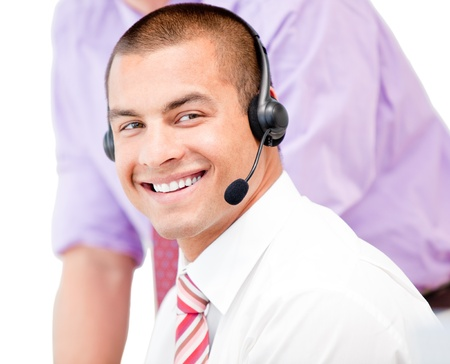 assertive: Portrait of a smiling businessman using a headset Stock Photo