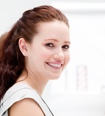 Portrait of a smiling businesswoman  during a meeting  photo