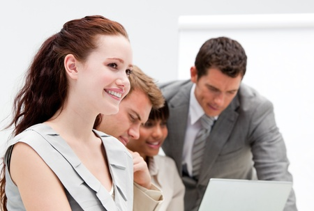 Portrait of a smiling businesswoman working with her colleagues photo