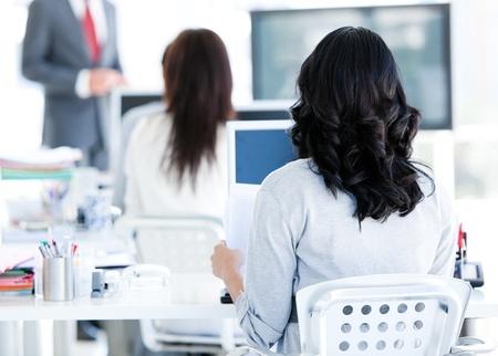 training consultant: Business team listenning a presentation