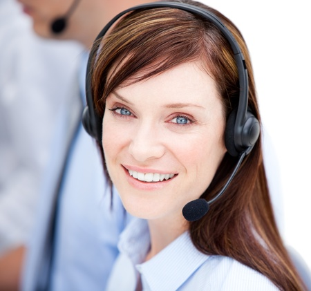 Portrait of caucasian businesswoman with headset on  photo