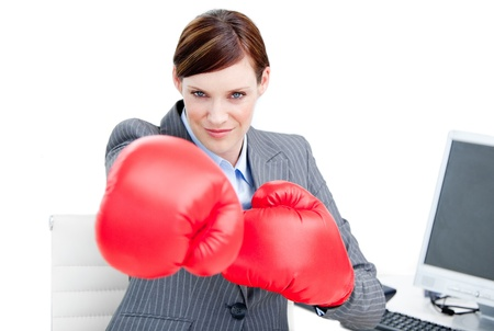 assertive: Portrait of a confident businesswoman wearing boxing gloves