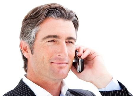 answering: Smiling businessman talking on the phone
