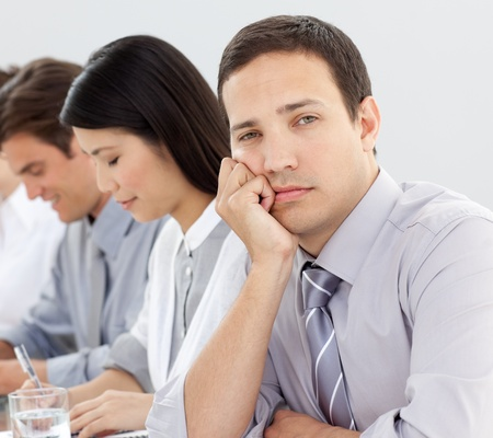 Young businessman bored in a meeting  photo