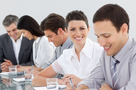 International business people taking notes in a meeting photo