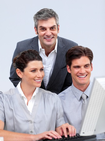 Enthusiastic businessteam working at a computer photo