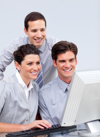 Lucky businessteam working at a computer Stock Photo - 10250199