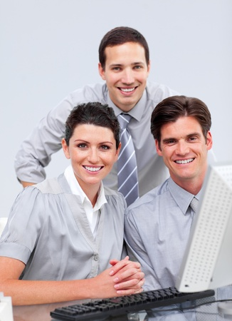 Fortunate businessteam working at a computer Stock Photo - 10250501