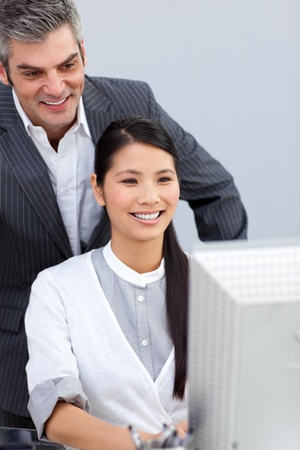 Smiling businesswoman helping by her manager photo