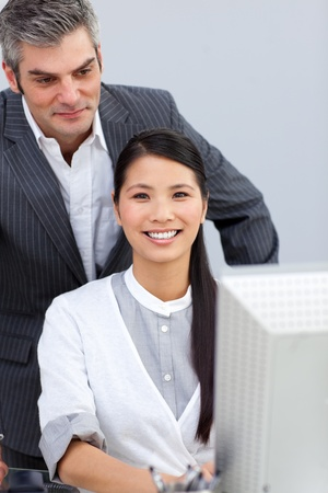 Laughing businesswoman helping by her manager Stock Photo - 10250211
