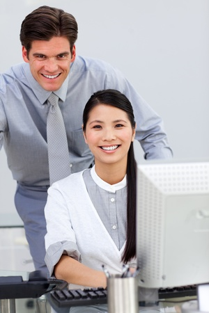Jolly businesswoman helping by her manager photo