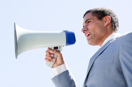 charismatic: Charismatic businessman yelling through a megaphone