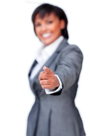 Smiling hispanic businesswoman pointing Stock Photo - 10249298