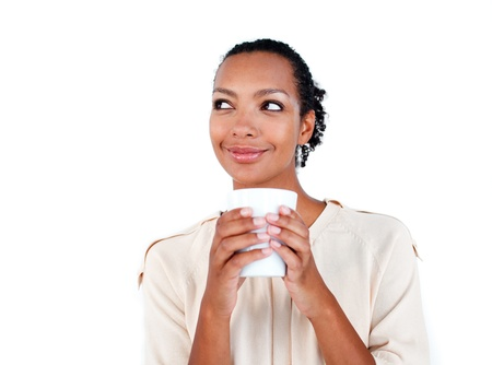 woman drinking milk: Attractive businesswoman drinking a coffee
