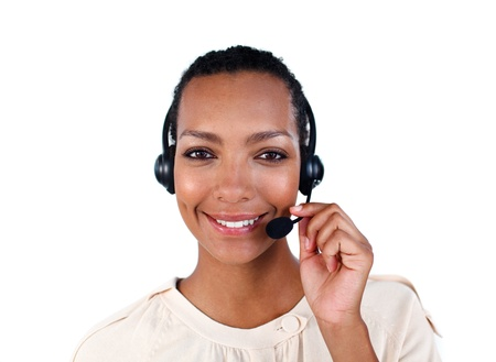 Smiling customer service representative with headset on Stock Photo - 10250299
