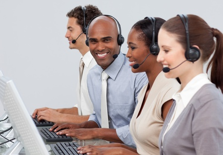 A diverse business group with headset on  photo
