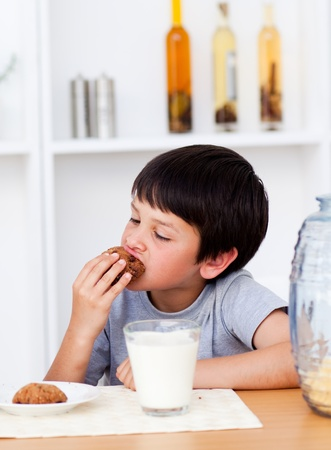 Boy eating cookies photo