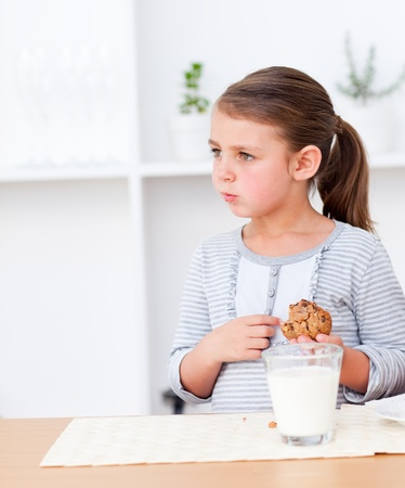 Portrait of a little girl eating cookies  Stock Photo - 10234209