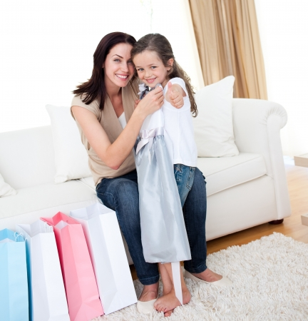 Little girl trying on a dress with her mother Stock Photo - 10250082