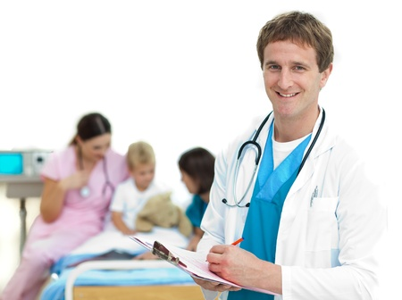 Serious doctor examining a patients folder  photo