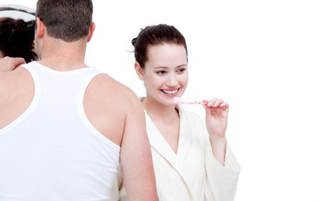 teeths: Charming couple brushing their teeths Stock Photo