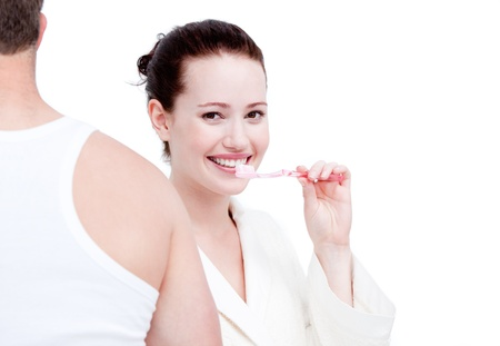hygeine: Charming couple brushing their teeths Stock Photo