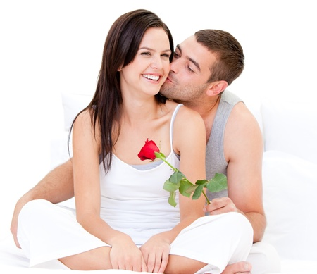 womanhood: Charming couple making a kiss Stock Photo